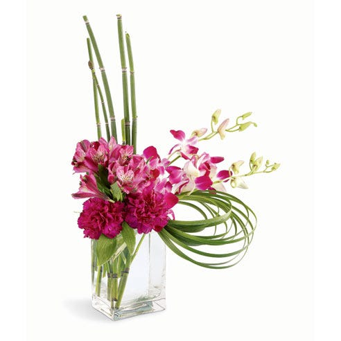 Tropical modern pink flower bouquet with pink dendrobium orchids and vase