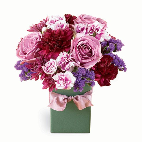 Mixed bouquet of purple flowers, lavender roses, cheap flowers, and pink flowers