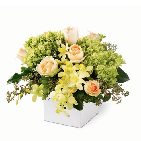 Green orchids in a green orchid bouquet with yellow orchids and ceramic vase