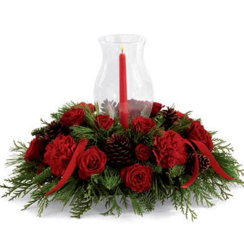 Holiday floral centerpiece with red carnations and spray roses