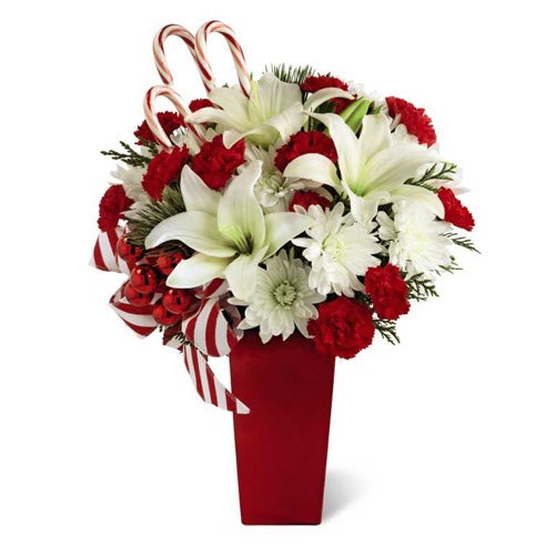 Candy cane bouquet with white asiatic lily, cheap flowers, and red carnations