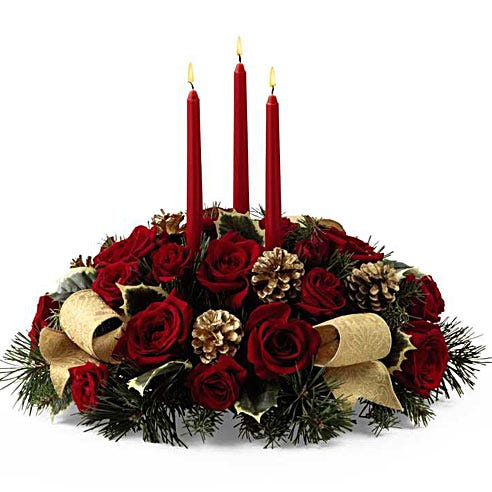 Red rose centerpiece with tapered candles with pine