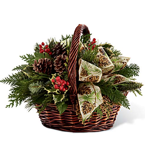 Holiday basket with holly, salal and pine cones for delivery this Christmas in a woven basket