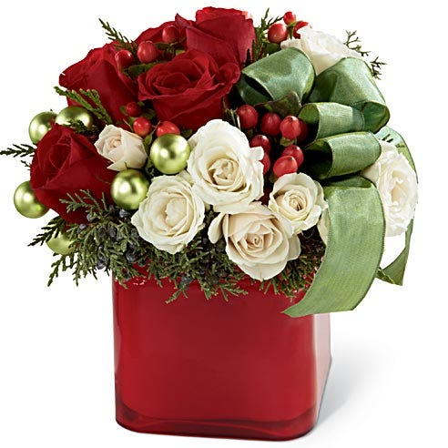 floral arrangement with red and white roses and decorations