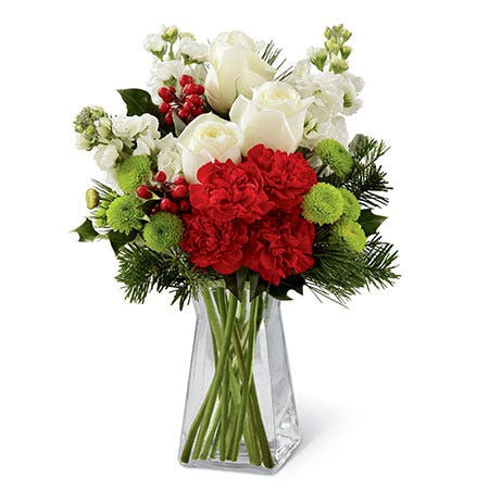 White roses, red carnations, and green poms Christmas flowers bouquet in a vase