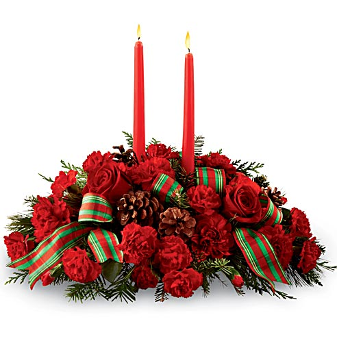Candle flower centerpiece with red roses, pinecones, red carnations and candles