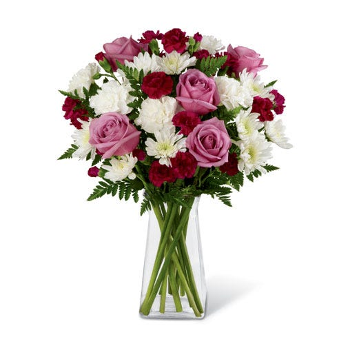 Spring flower bouquet with lavender roses, white and red carnations and vase