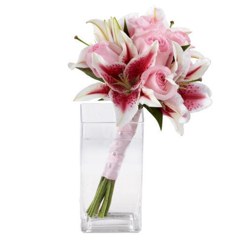 Pink roses with cheap flowers & asiatic lilies delivered wrapped in glass vase