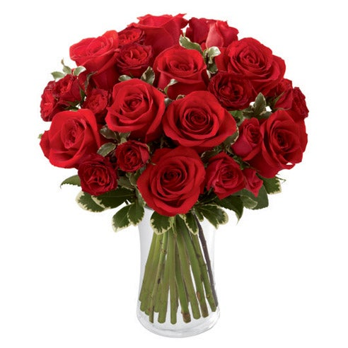 Cute valentines day gift delivery of red roses in a glass vase