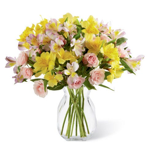 Yellow peruvian lilies and pink spray rose bouquet