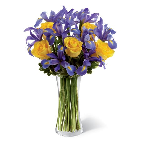 Blue and purple iris with yellow roses