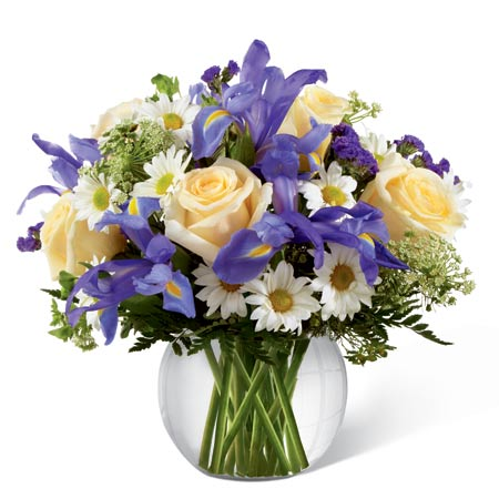 Mardi Gras flower centerpiece with purple iris and pale pink roses delivery