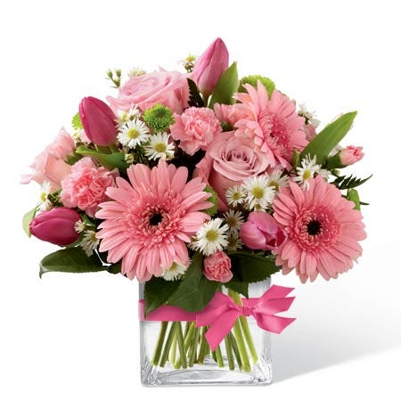 Flower arrangement with pink roses and pink tulips