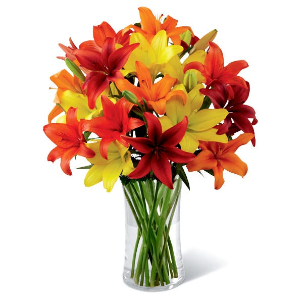 Yellow, orange and red asiatic lilies in a thanksgiving arrangement