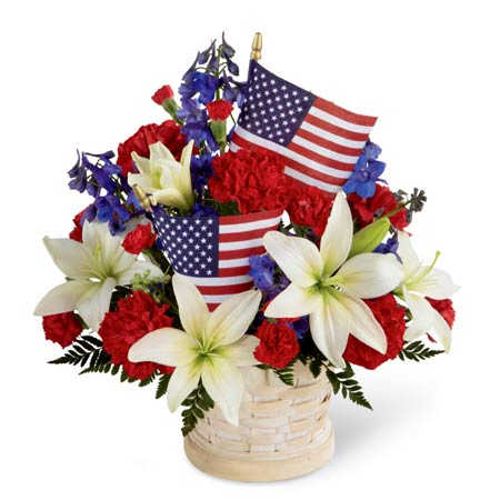 White lily flowers and american flag arrangement