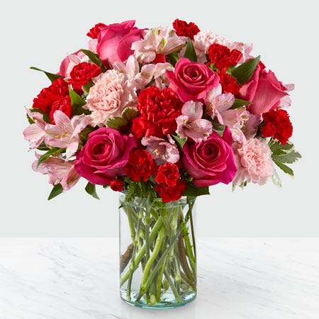 Hot pink roses, light pink carnations and hot pink carnations mixed spring bouquet