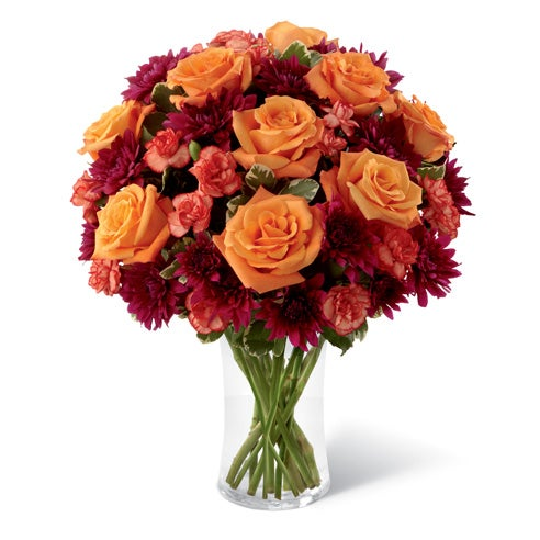 Orange roses and red mini carnations in Fall bouquet with cheap flowers