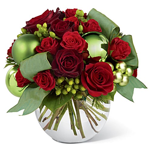 Unique holiday bouquet with red roses and spray roses with hypericum berries