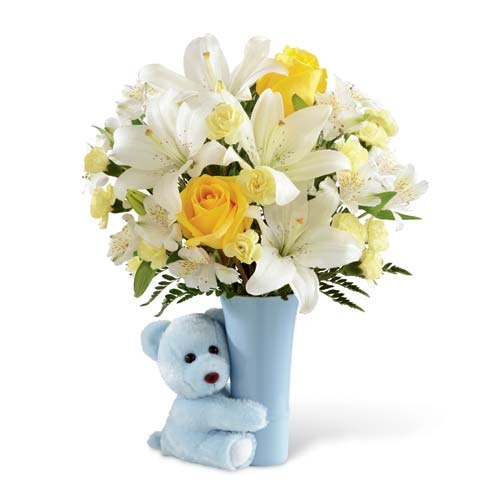Yellow roses, pale yellow carnations, white Peruvian lilies