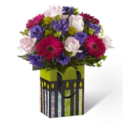 FTD birthday flowers with pink roses, gerbera daisies and festive bag