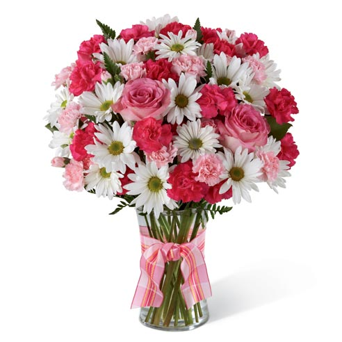 White daisies, red spray roses, pink spray roses delivered by a florist in a glass vase