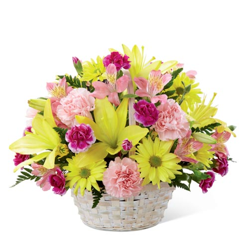Cheap flowers in a woven basket with yellow lilies, daisies and carnations