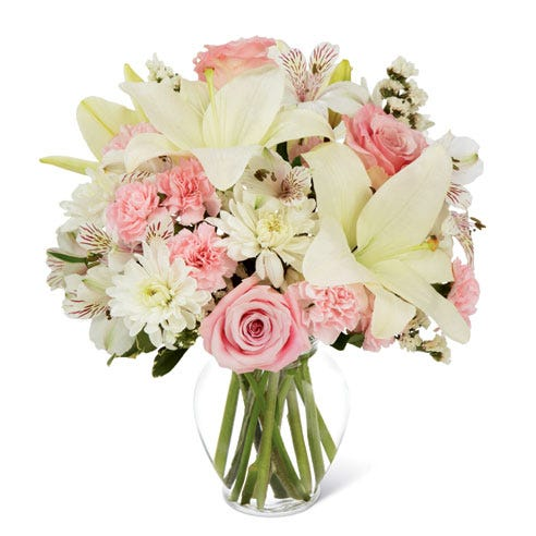 White asiatic and pink peruvian lily bouquet with statice and pink carnations
