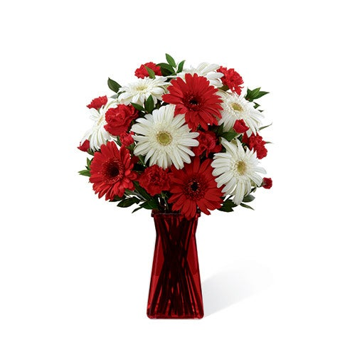 White gerbera daisies, red gerbera daisies and mini carnations with greens in a ruby gathered square vase