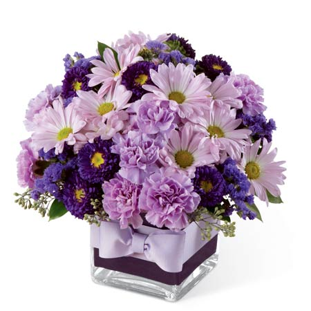 Lavender daisy bouquet of traditional daisies and purple carnations