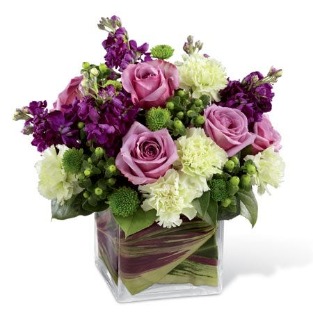 Purple rose bouquet of lavender roses, green carnations & hypericum berries