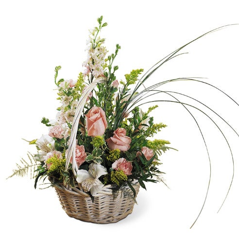 Peach roses and pink flowers delivered in a basket