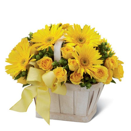 Yellow gerbera daisies and yellow spray roses in a flower basket bouquet