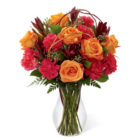 Fall flower delivery of orange spray roses and pink fuchsia carnations