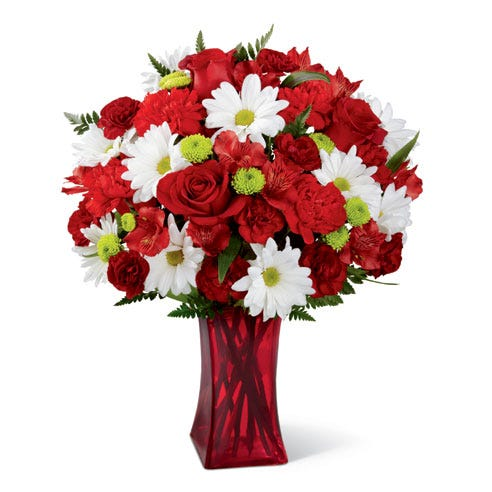 Mixed bouquet of red roses, white daisies, and red carnations