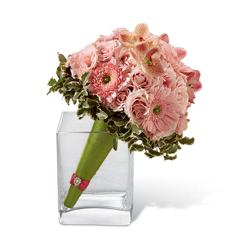 Pink Mokara orchids, mini gerbera diaises, and spray roses accented with greens and arranged within a green cone