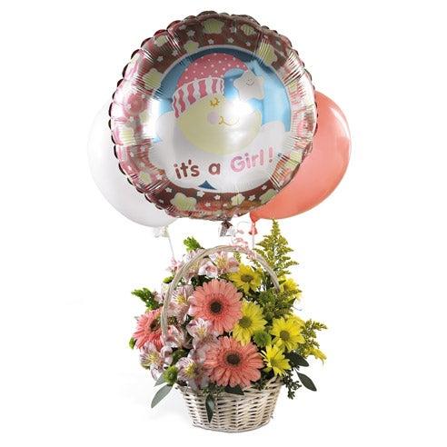 Pink and yellow flowers delivered in basket with it's a new baby balloon