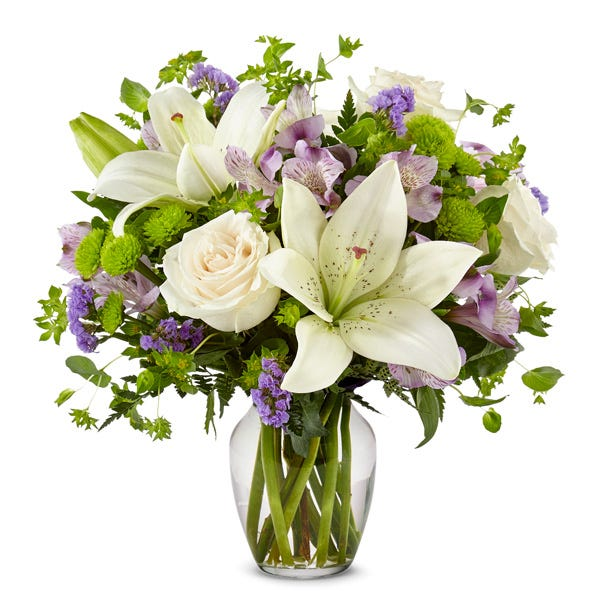 Lavender white lily arrangement with white roses