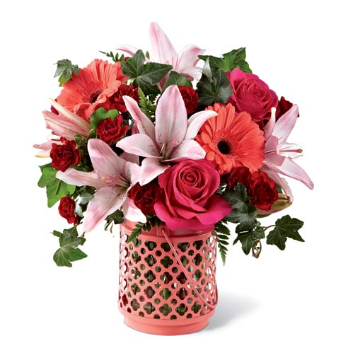 Coral daisy, pink lily, and pink and red rose bouquet