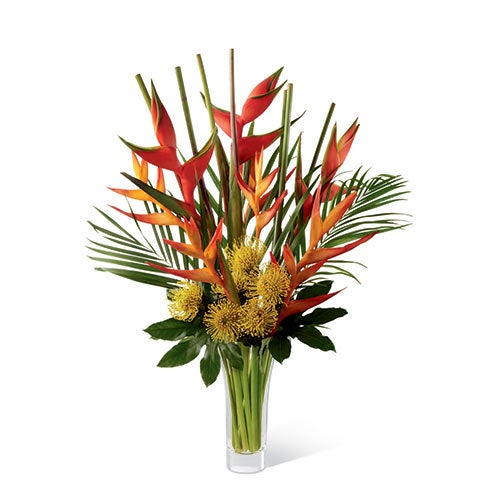 Pincushion protea, psitticorum heliconia, upright heliconia, aralia leaves, and areca palm in a superior flared clear glass vase