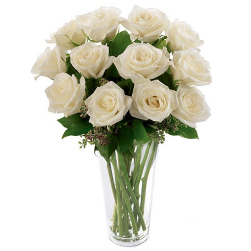 long stem white roses bouquet with seeded eucalyptus and glass vase