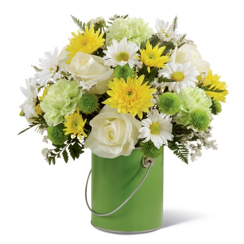 Green carnations, white roses, yellow cushion poms & white daisies in a green container