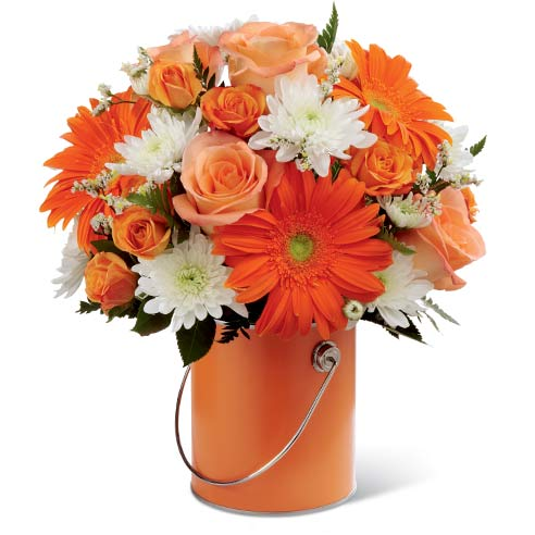 Orange paint can flower arrangement with orange gerbera daisies and roses