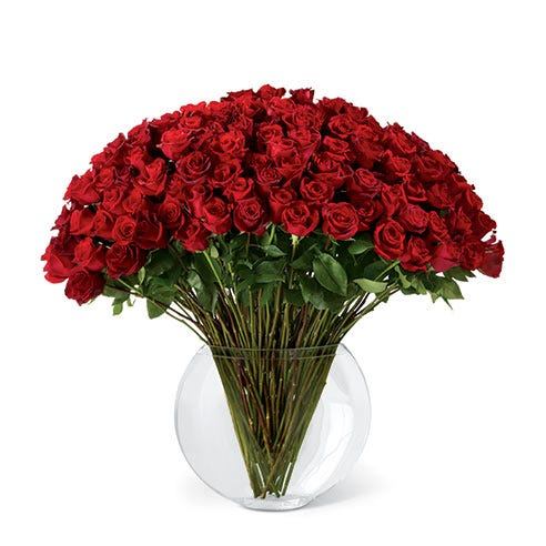 100 long stem red roses bouquet with a large round glass vase and card