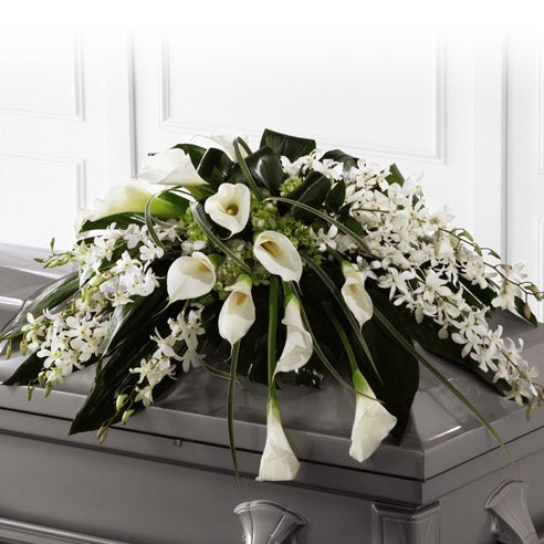 White orchids and calla lilies delivered by a florist