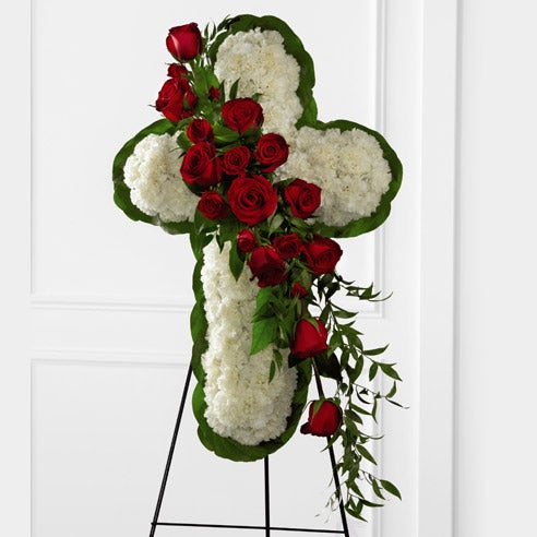 Cross shaped standing spray with red roses and white carnations