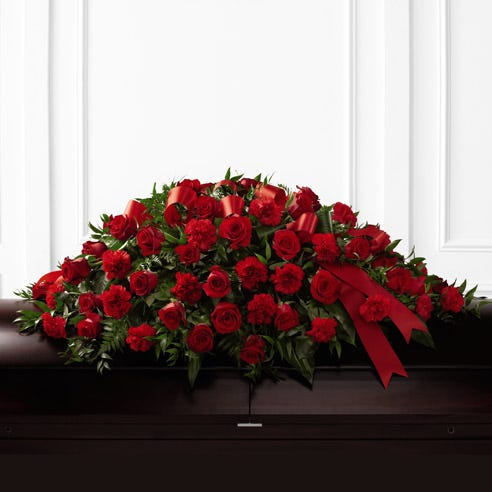 Red roses and red carnations in a casket spray