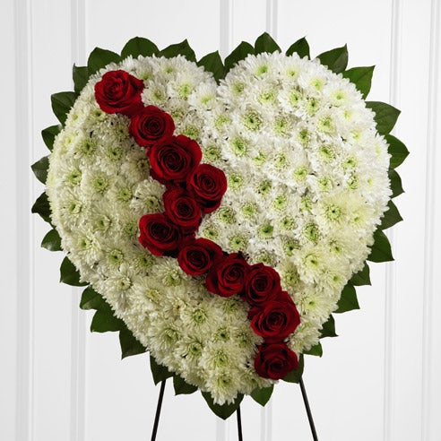 White sprays roses and white asiatic lily heart shaped standing spray delivery