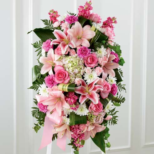 Oval pink rose, pink pompon and white hydrangea funeral standing spray