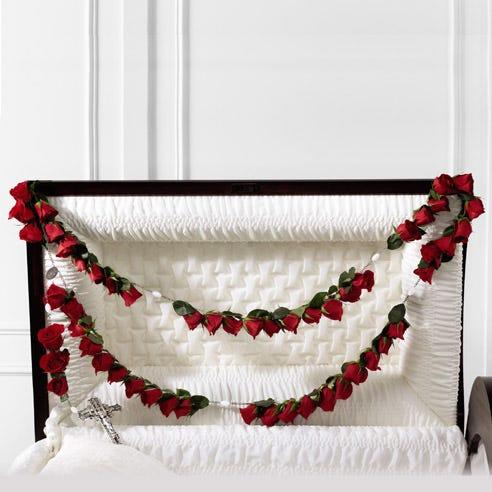 Red rose sympathy casket rosary arrangement