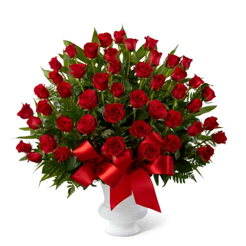 Red rose bouquet delivered in a sympathy urn